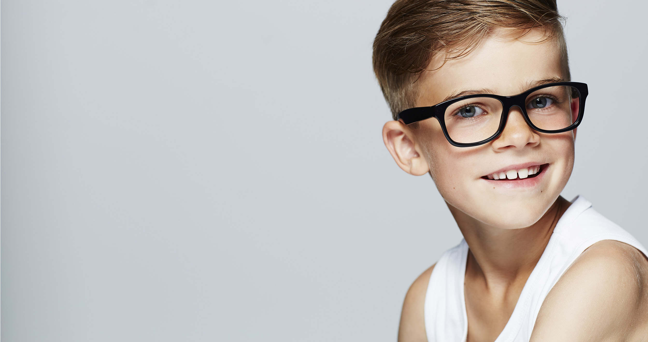 young boy with large glasses